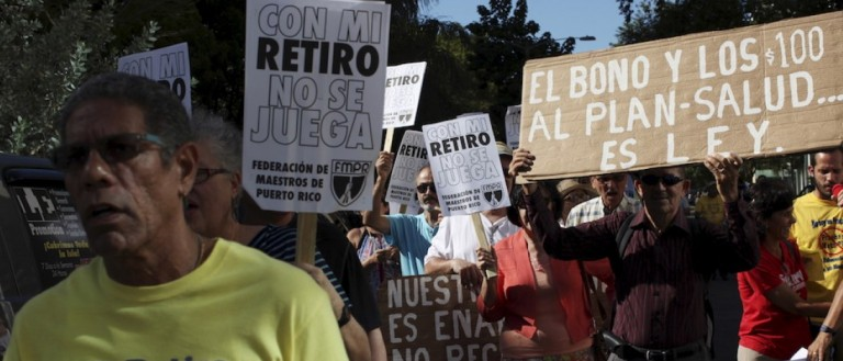 Members of the Committee of retired Teachers of Puerto Rico's Teachers Federation protest. (REUTERS/Alvin Baez)