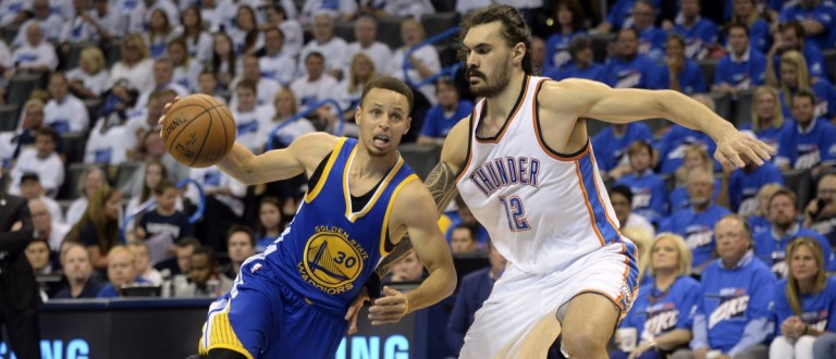 Golden State Warriors guard Stephen Curry drives to the basket as Oklahoma City Thunder center Steven Adams defends during the third quarter in game three of the Western conference finals of the NBA Playoffs at Chesapeake Energy Arena