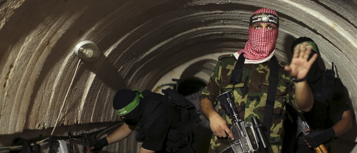A Palestinian fighter from the Izz el-Deen al-Qassam Brigades, the armed wing of the Hamas movement, gestures inside an underground tunnel in Gaza in this August 18, 2014 file photo.  REUTERS/Mohammed Salem/Files