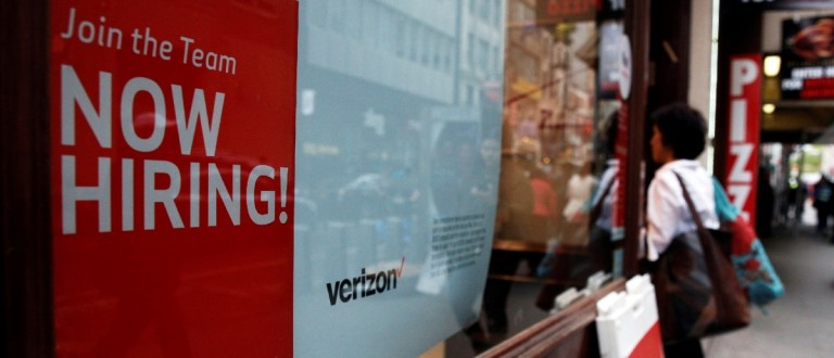 """A """"Now Hiring"""" sign is posted on a Verizon store (REUTERS/Brendan McDermid)"""