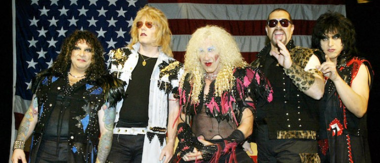 Members of the reunited metal band Twisted Sister, A.J. Pero (L), J.J. French (2nd L), Dee Snider (C), Mark Mendoza (2nd R), and Eddie Ojeda (R) pose for photos before a press conference in New York on April 29, 2003 where they discussed their upcoming USO tour and U.S. and European appearances. On behalf of the USO, the band will perform at one Air Force base and two Army bases in South Korea. - RTXLX6A (photo:Reuters)