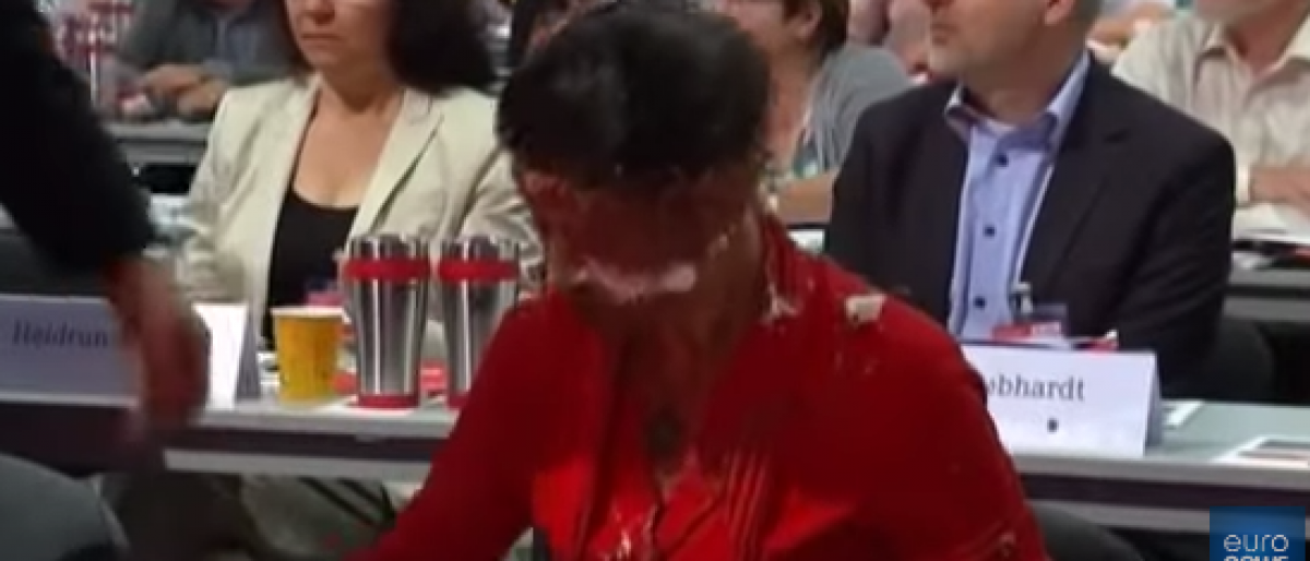 Sahra Wagenknecht, a member of parliament for Germany's Left party, was hit in the face with a chocolate cake Saturday. (Screenshot from YouTube / Euronews)