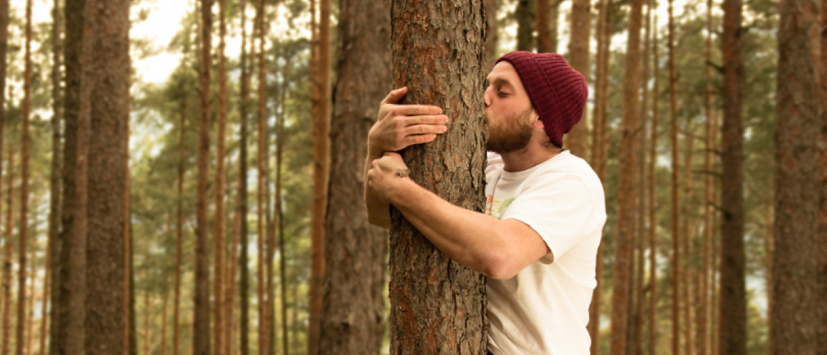 Hugging trees to support nature (Copyright: gidl)