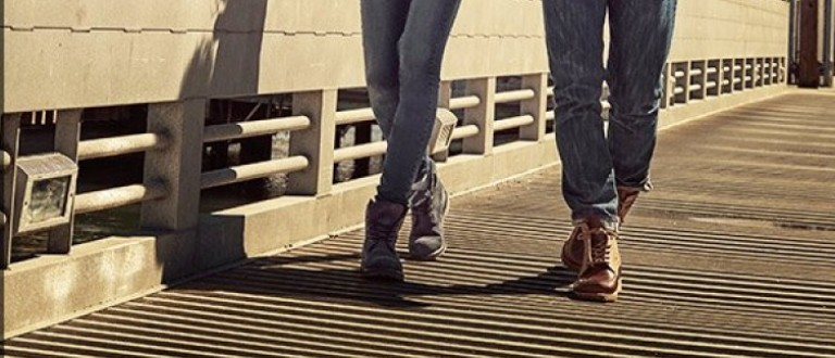 A man and a woman walk in Timberlands (Photo via Amazon/Timberland)