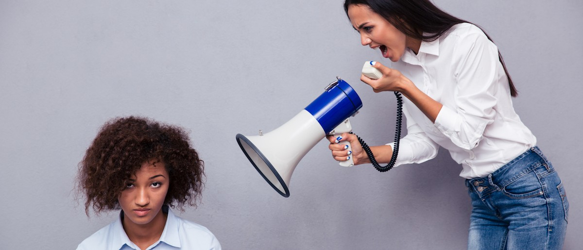 Woman shouting through loudspaker on her friend over gray background Half of all misogynistic tweets are sent by women, according to a new study from the left-leaning think tank Demos.