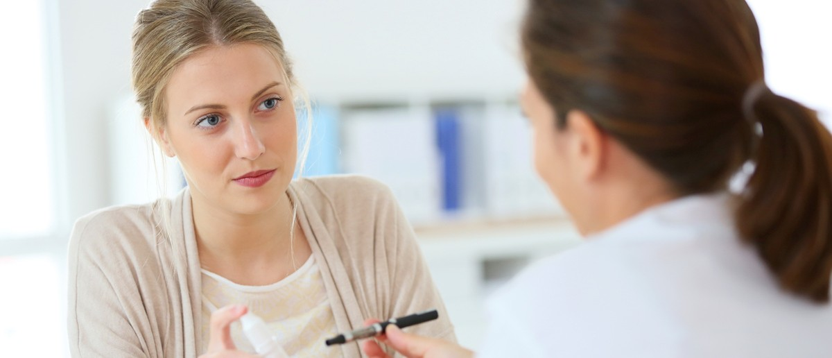 Young woman getting information about electronic cigarette (Credit: Shutterstock/goodluz)
