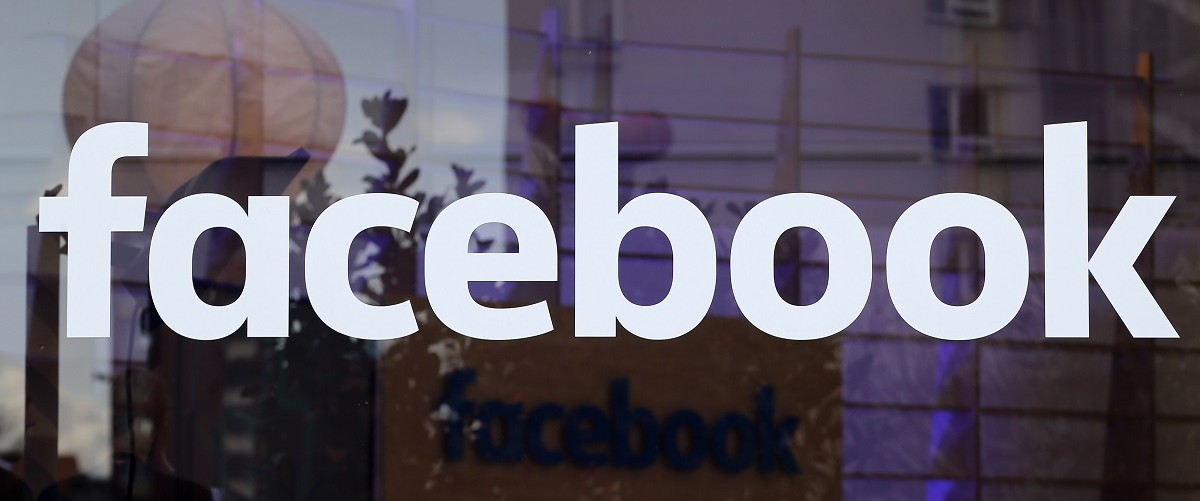 The logo of Facebook is pictured on a window at new Facebook Innovation Hub in Berlin