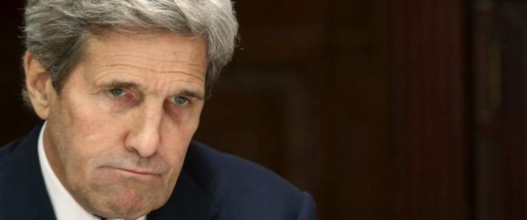 Kerry listens as Zarif speaks to the media during a meeting in New York