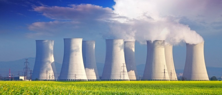 Nuclear power plant with yellow field and big blue clouds. Shutterstock.com/TTstudio