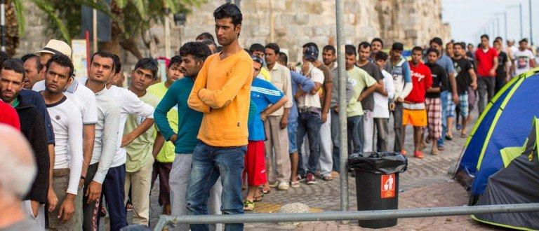 KOS, GREECEUnidentified refugees (Shutterstock) - SEP 28, 2015: Unidentified refugees. More than half are migrants from Syria, but there are refugees from other countries - Afghanistan, Pakistan, Iraq, Iran, Mali, Bangladesh, Eritrea. Shutterstock/De Visu