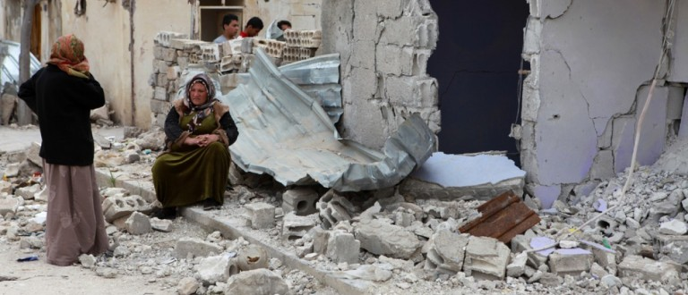 Syrian women converse near a bombed-out building in Serekaniye, Syria. Source: fpolat89/Shutterstock