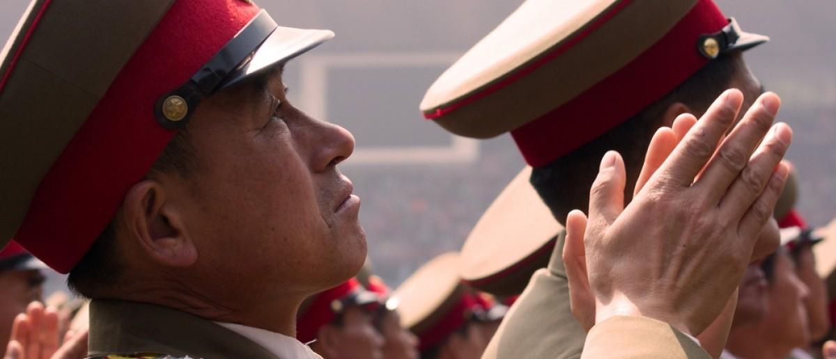 North Korean soldiers cheers Kim Jong-un. Source: Astrelok/Shutterstock