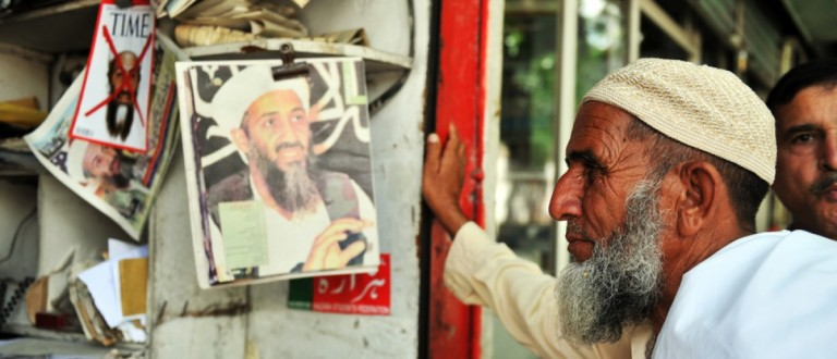 Man looks over magazines and newspapers after the bin Laden raid. Source: Thomas Koch/Shutterstock