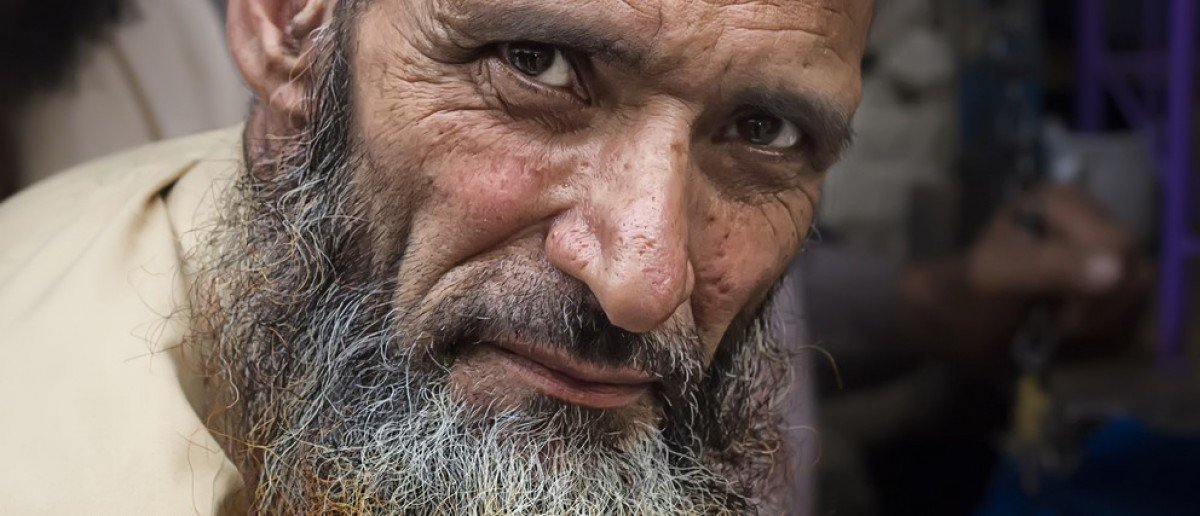 LAHORE, PAKISTAN - APRIL 26, 2013: Pashto refugee in Pakistan with henna dyed beard. According to UNHCR there are 1.6 million registered afghan refugees in Pakistan. (Credit: gaborbasch / Shutterstock.com)