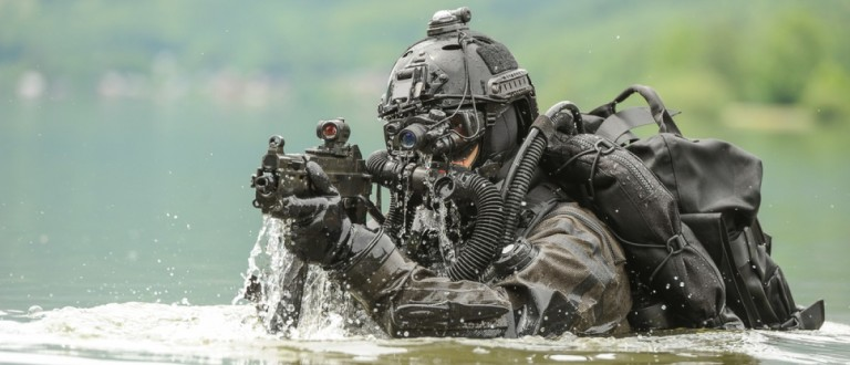 A special operations diver rises from the water. Source: MilanTomazin/Shutterstrock