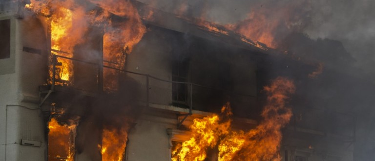 Flames roar as a building is engulfed. Source: TFrancis/Shutterstock