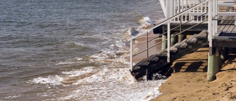 Erosion caused by rising sea levels due to global warming (ribeiroantonio/Shuttershock)