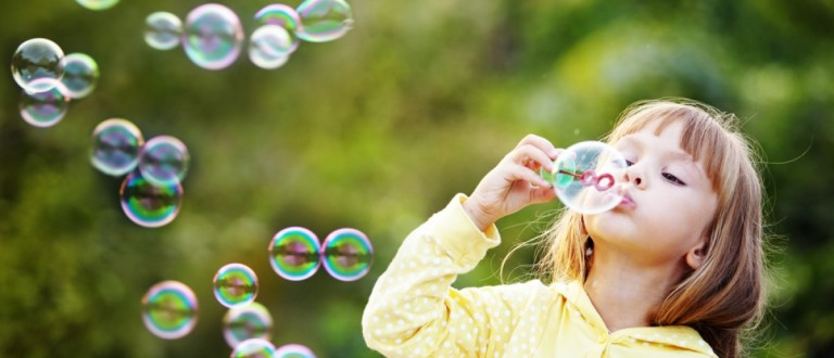 Child blowing bubbles (Credit: Alena Ozerova/Shutterstock)