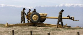 Afghan National Army (ANA) soldiers clean an artillery at the hilltop of Dand Ghori district of Baghlan
