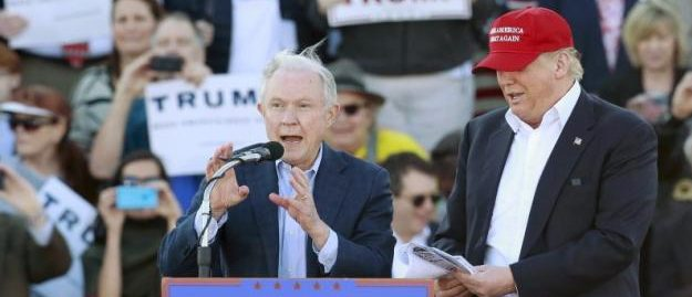 Senator Jeff Sessions speaks next to Republican presidential candidate Donald Trump at a rally at Madison City Schools Stadium in Madison, Alabama February 28, 2016. REUTERS/Marvin Gentry