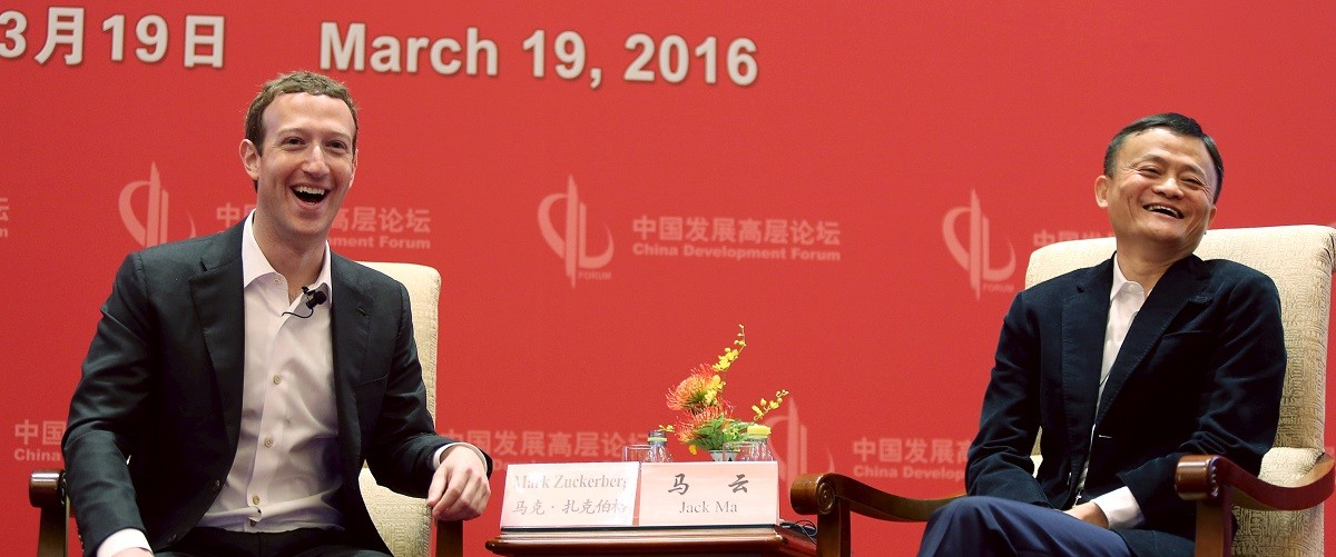 Facebook founder and CEO Mark Zuckerberg and Founder and Executive Chairman of Alibaba Group Jack Ma laugh as they meet at the China Development Forum in Beijing, China, March 19, 2016. REUTERS/Shu Zhang.