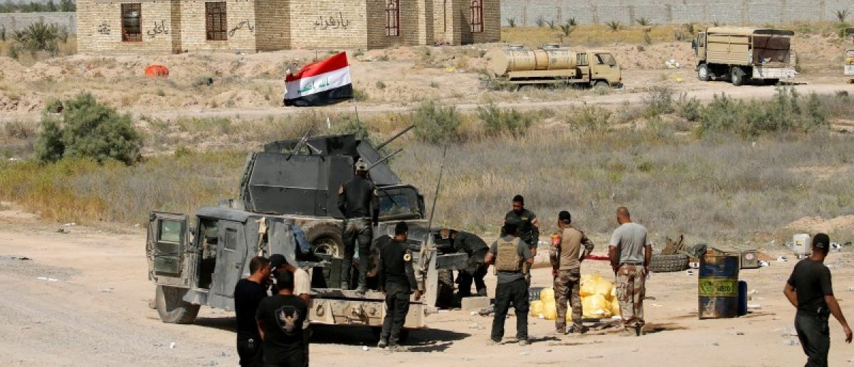 Iraqi security forces gather near Fallujah, Iraq, May 31, 2016. REUTERS/Thaier Al-Sudani