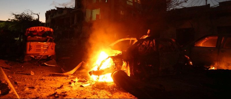 A vehicle burns at the scene of a suicide car bombing outside Hotel Ambassador on Maka Al Mukaram Road in Somalia's capital Mogadishu
