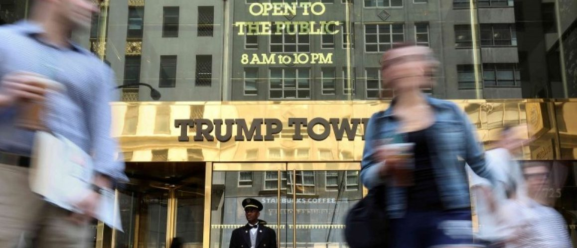 A doorman stands as people walk past the Trump Tower in New York, U.S., May 23, 2016.  REUTERS/Carlo Allegri/File Photo