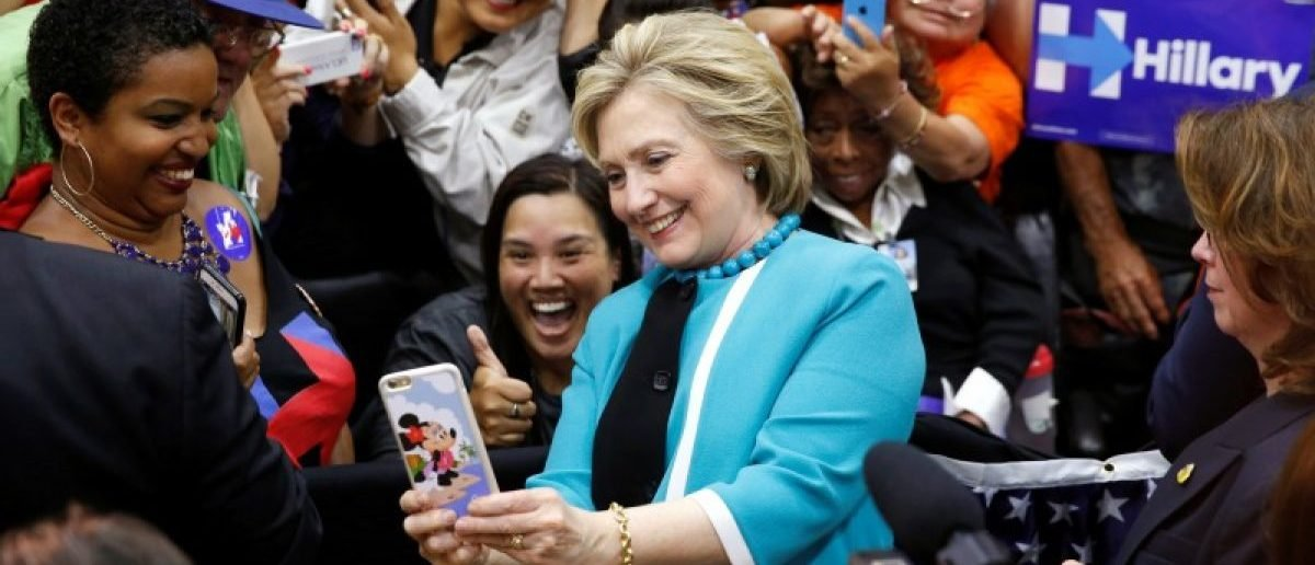 Democratic presidential candidate Hillary Clinton takes a selfie with the audience at East Los Angeles College in Los Angeles, California, U.S., May 5, 2016. REUTERS/Lucy Nicholson