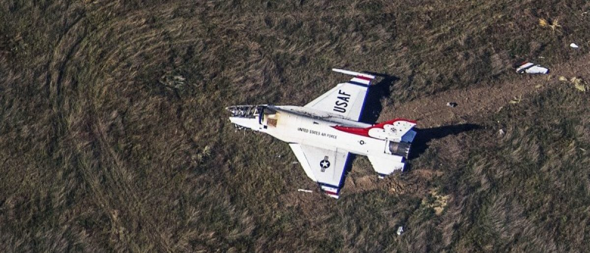 An Air Force F-16 with the Thunderbirds air demonstration squadron sits crashed in a field 4 miles south of Colorado Springs after performing a fly-by of the U.S. Air Force Academy graduation ceremony. REUTERS/John Wark