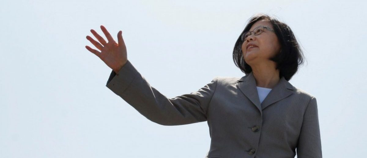 Taiwanese President Tsai Ing-wen waves her hand as she boards the nation's first domestically built 500-ton Tuo Jiang twin-hull stealth missile corvette at Suao Naval Base in Yilan, Taiwan June 4, 2016. REUTERS/Tyrone Siu
