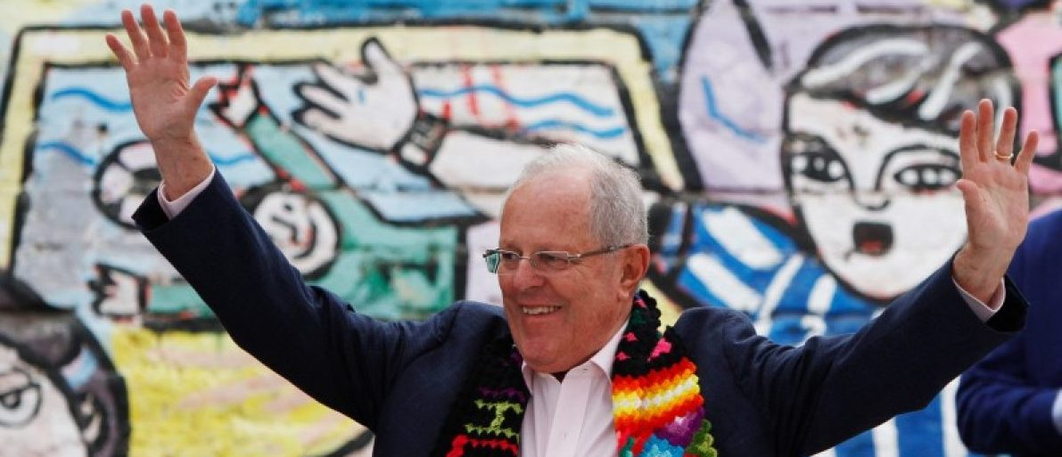 Peruvian presidential candidate Pedro Pablo Kuczynski waves at a breakfast meeting in Lima