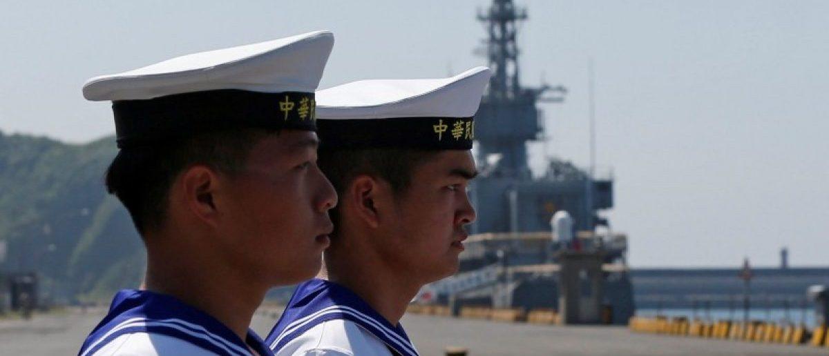 Taiwanese navy personnel walk at Suao Naval Base in Yilan, Taiwan June 4, 2016. REUTERS/Tyrone Siu