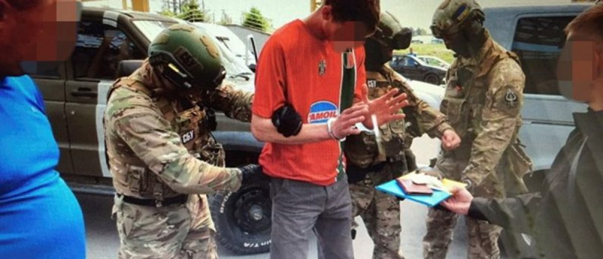 Members of Ukraine's state security service detain a French citizen who had been planning attacks in France to coincide with the Euro 2016 football championship it is hosting, on the Ukrainian-Polish border in Volyn region, Ukraine, in this undated photo released by Ukraine's state security service on June 6, 2016. Picture pixellated at source. Ukraine's State Security Service/Handout via REUTERS