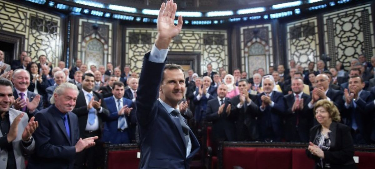 Syria's president Bashar al-Assad gestures while parliament members clap in Damascus, Syria in this handout picture provided by SANA on June 7, 2016. SANA/Handout