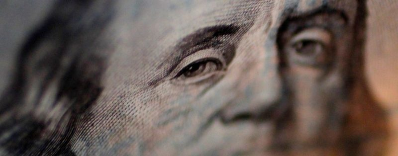 A portrait of Benjamin Franklin on a U.S. One-hundred dollar bill is pictured at Interbank Inc. money exchange in Tokyo, in this September 9, 2010 picture illustration. REUTERS/Yuriko Nakao/File Photo