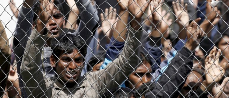 Migrants who will be returned to Turkey demonstrate inside the Moria registration centre on the Greek island of Lesbos, April 5, 2016. REUTERS/Giorgos Moutafis/File Photo
