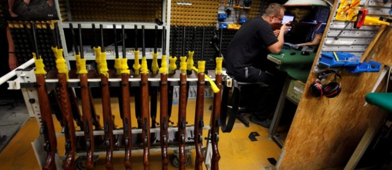 A worker fires a newly assembled rifle in the Ceska Zbrojovka weapons factory in Uhersky Brod, Czech Republic, May 27, 2016. REUTERS/David W Cerny