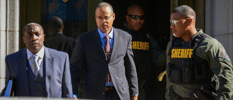 Officer Caesar Goodson leaves the courthouse following the first day of his trial in Baltimore