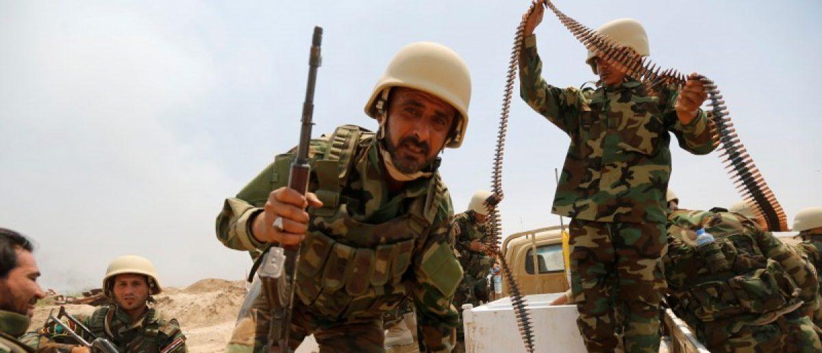 Fighters from Iraqi Shiite group Kataib Sayyid al-Shuhada gather near Falluja. REUTERS/Thaier Al-Sudani