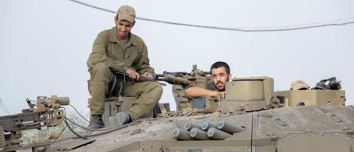 IDF soldiers sit on an IDF tank. Source: Katie Frates/Flickr.