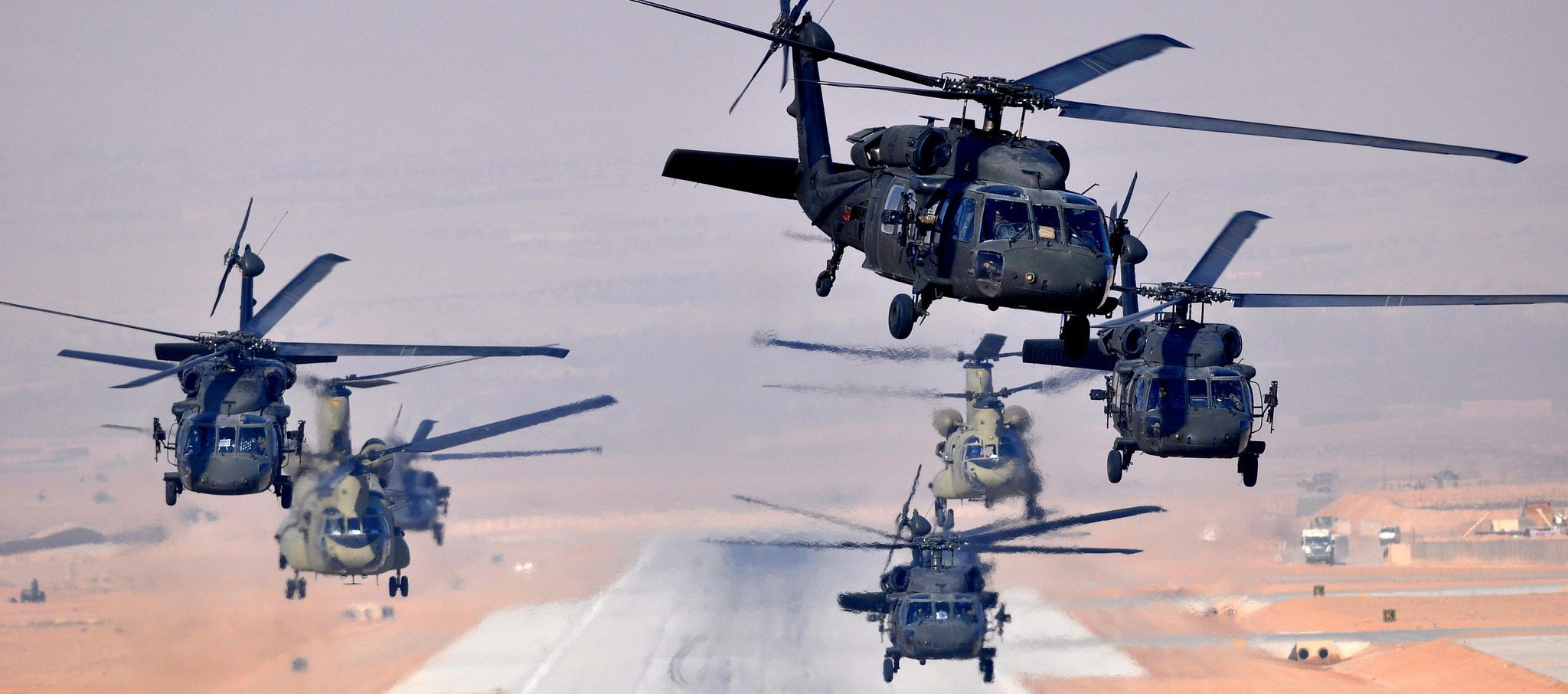 Six UH-60L Black Hawks and two CH-47F Chinooks, assigned to Task Force Brawler, 4th Battalion, 3rd Aviation Regiment, Task Force Falcon, simultaneously launch a daytime mission Jan. 18 from Multinational Base Tarin Kowt. (US Army official image)