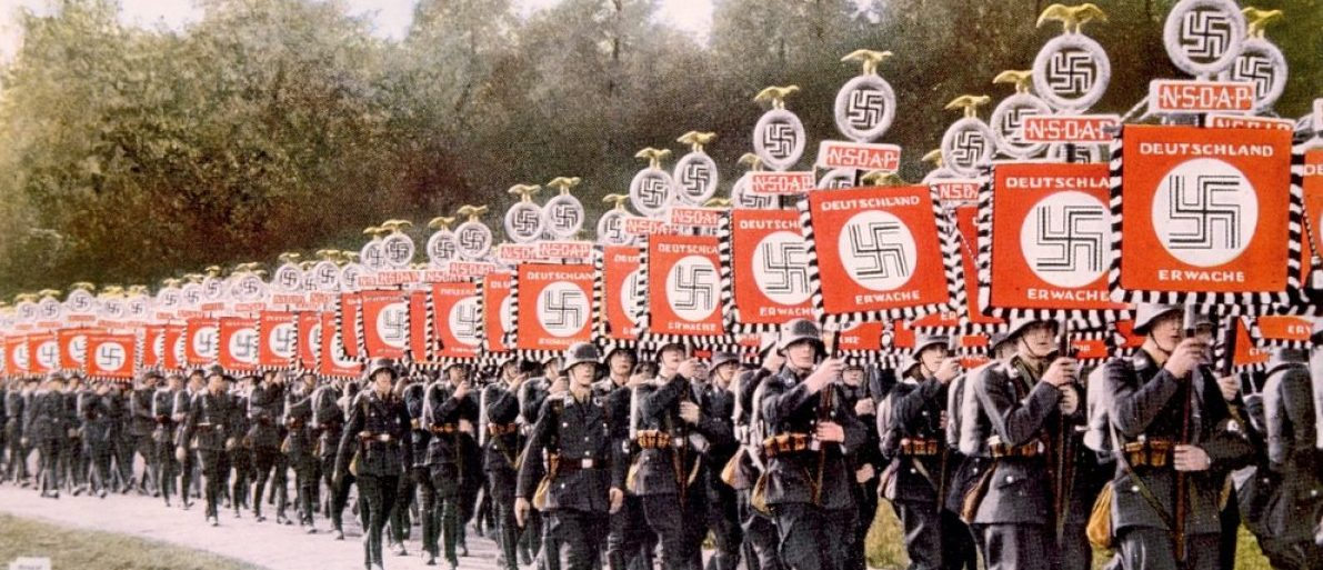 Nazi Germany, Nazi SS troops marching with victory standards at the party day rally in Nuremberg. Shutterstock/Everett Historical