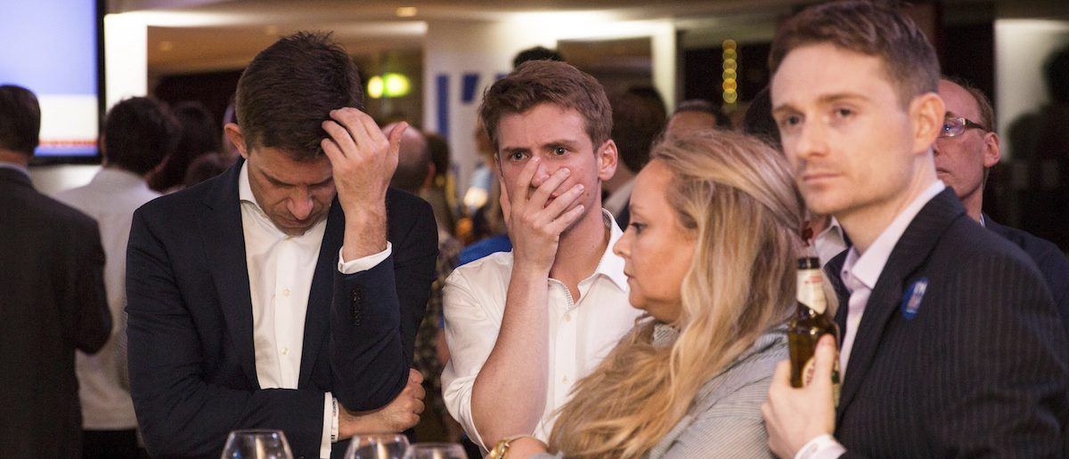 Supporters of the Stronger In Campaign react as results of the EU referendum are announced at the Royal Festival Hall, in London, Britain June 24, 2016. REUTERS/Rob Stothard/Pool - RTX2HW0P