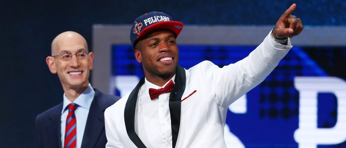 Buddy Hield (Oklahoma) gestures while next to NBA commissioner Adam Silver after being selected as the number six overall pick to the New Orleans Pelicans in the first round of the 2016 NBA Draft at Barclays Center. (Jerry Lai-USA TODAY Sports)