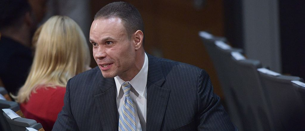 Secret Service agent-turned-politician Dan Bongino chats with an attendee before the start of a discussion on reforming the criminal justice system by Senator Rand Paul at Bowie State University on March 13, 2015
