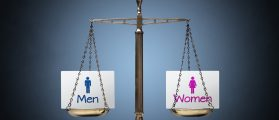Equality between man and woman concept with beam scales (Shutterstock/Brian A Jackson)