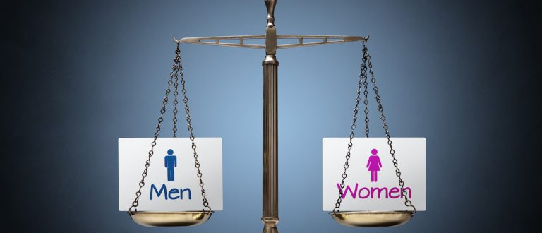 Equality between man and woman concept with beam scales