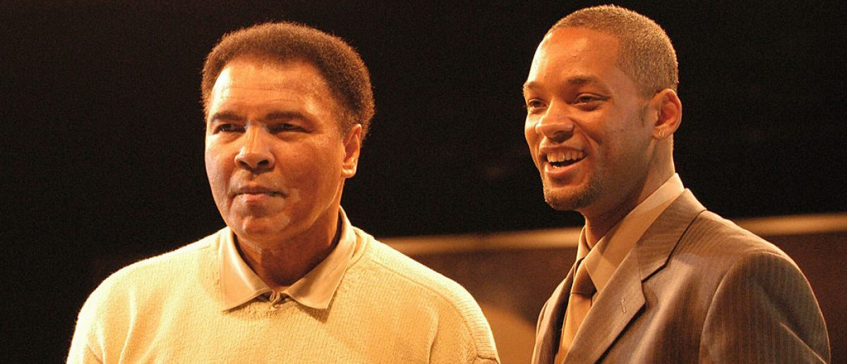 "Boxing legend Muhammad Ali stands with actor Will Smith at the Miami Art Basel Taschen book premiere of Ali's new book, ""GOAT - Greatest Of All Time"" at the Miami Convention Center December 6, 2003 in Miami"
