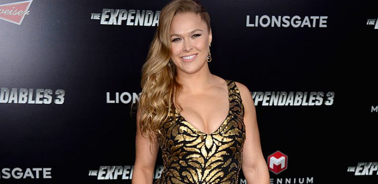 Ronda looking amazing in her gold dress! (photo: Getty)